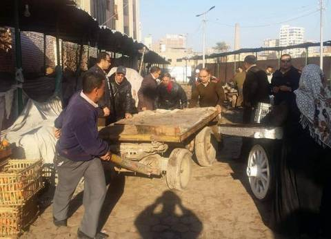 تحرير 65 مخالفة إشغالات متنوعة وإزالة 29 حاجزا خرسانيا وحديديا بأسيوط