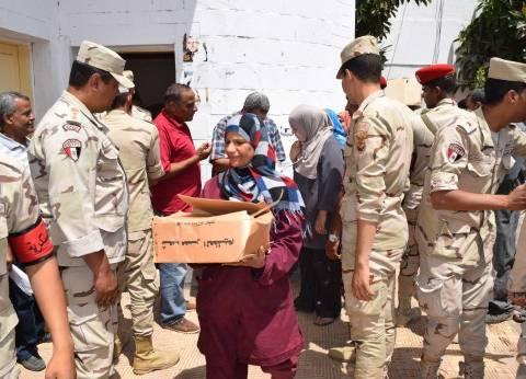 القوات المسلحة توزع 68 ألف كرتونة سلع غذائية على الفقراء في المنيا