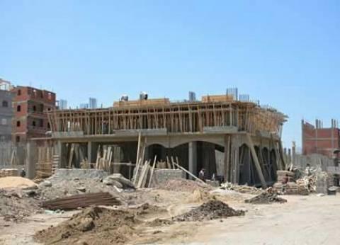 وقف أعمال بناء 4 أبراج مخالفة بمركز المنيا