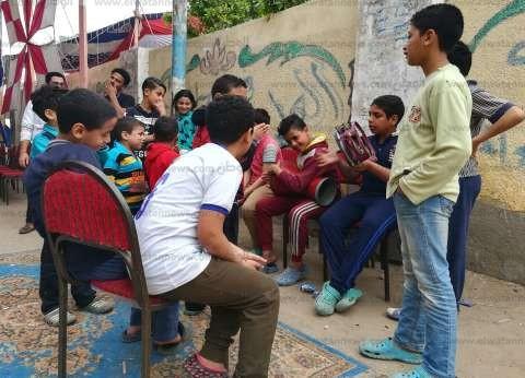 """أطفال يستقبلون الناخبين بالطبول أمام لجان """"بلقاس"""" بالدقهلية"""
