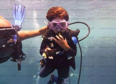 """آدم """"كي جي 2"""" أصغر غطاس في العالم لم يتخط السادسة من عمره"""