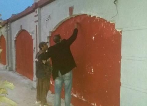 حي وسط بالإسكندرية يستكمل أعمال دهان أرض كوتة بالكورنيش
