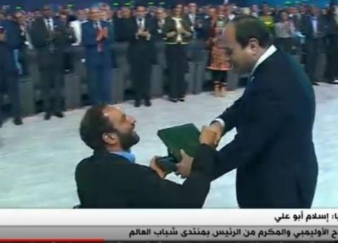 """السباح إسلام أبو علي: """"فخور بتكريم السيسي.. وحضور منتدى الشباب شرف"""""""