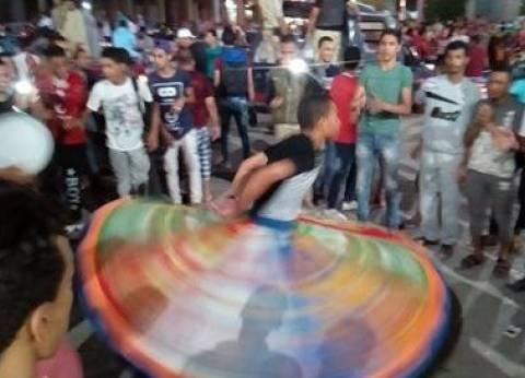 راقصو التنورة يشاركون أبناء الوادي الجديد فرحتهم بالصعود لكأس العالم