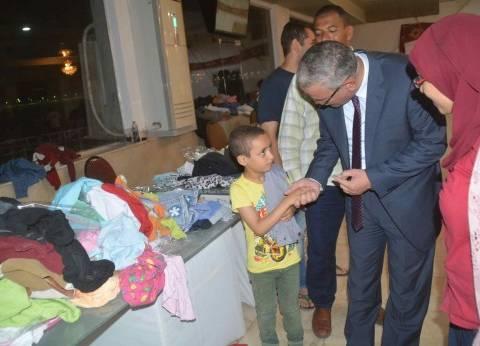 """افتتاح معرض """"يوم الكساء"""" الخيري لجمعية """"رسالة"""" في المنيا"""