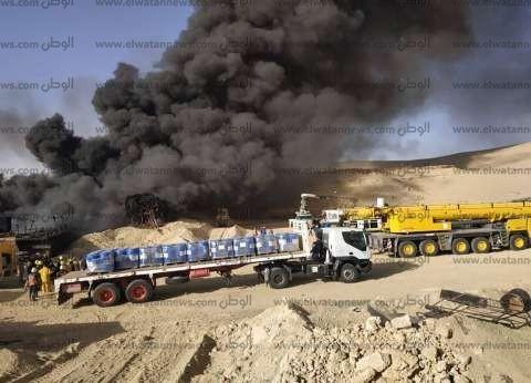"""مصدر بالعامة للبترول: الدفع بـ25 سيارة فوم ومياه لإخماد حريق بئر """"عسل"""""""