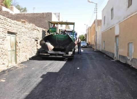 رصف الطرق وإزالة مياه الصرف من شوارع العامرية بالإسكندرية
