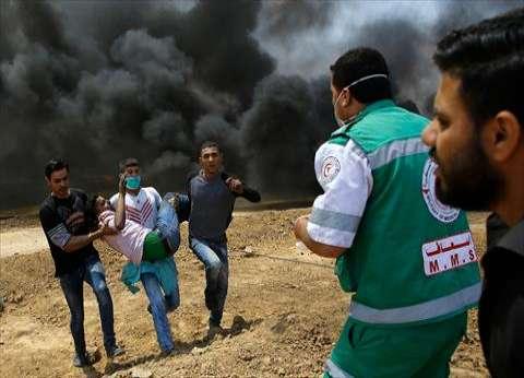 شهيدان فلسطينيان و124 مصابا على طول حدود قطاع غزة