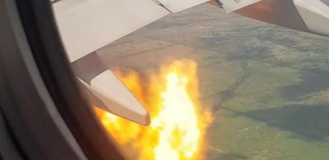 فيديو| لقطات تحبس الأنفاس.. مسافر يوثق لحظة اشتعال محرك طائرته في الجو