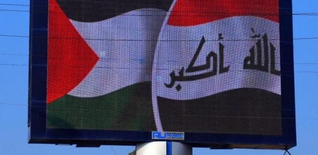 العلم الفلسطيني بدلا من الأردني في بغداد ترحيبا بالملك عبدالله الثاني