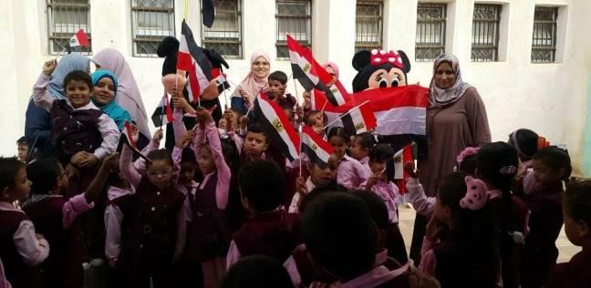 صور| بأيدي طلابها.. مدرسة بئر العبد الابتدائية تتزين لاستقبال الناخبين