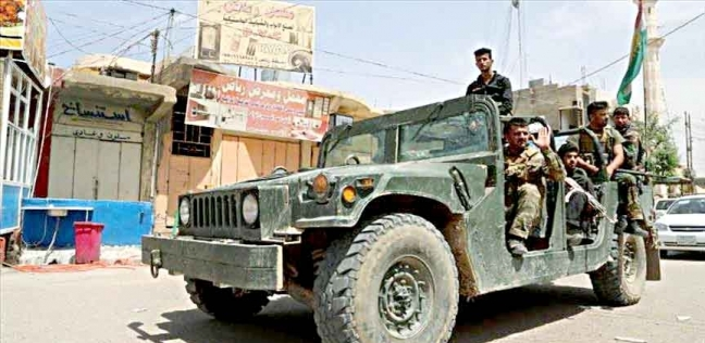 القوات الأمنية تنتشر وسط بغداد وتقطع طرق ساحة التحرير