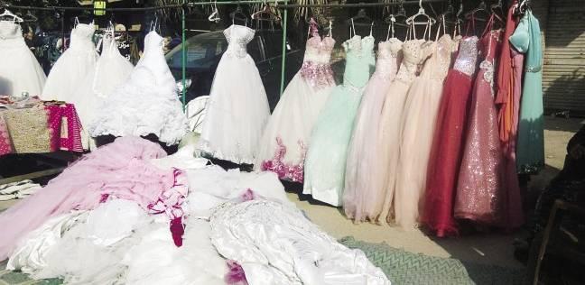7722138a1 الوطن | منوعات | «حمص» يبيع فساتين زفاف على الرصيف: «بـ100 جنيه ...