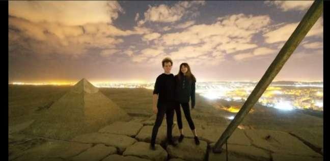 بالفيديو والصور  القصة الكاملة لتصوير مقطع إباحي أعلى الهرم