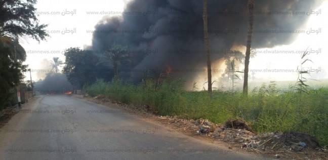 إخماد حريق في سيارتين مواد بترولية بطريق فرعي ببني سويف عقب تصادمهما