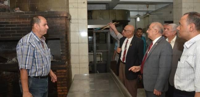 بالصور| رئيس جامعة أسيوط يتفقد آثار حريق محدودة بمدخنة دار الضيافة