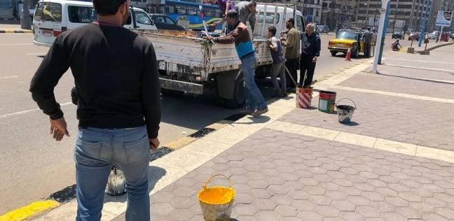 استكمال أعمال دهانات أرصفة شرق الإسكندرية