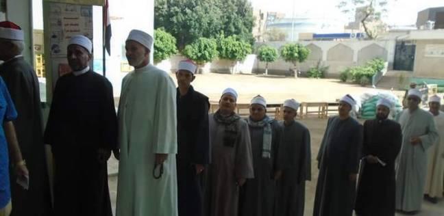 رجال الأزهر يدلون بأصواتهم في الانتخابات بزيهم الرسمي في سوهاج