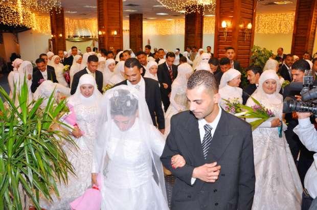 بالصور| جمعية الأورمان تدعم زواج 16 فتاة يتيمة في الفيوم