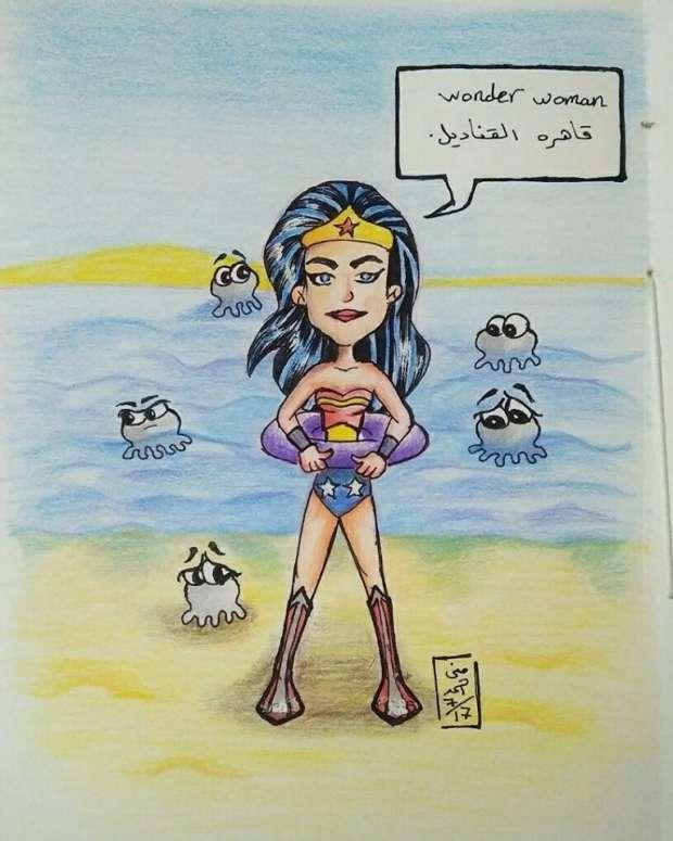 """بالصور  """"وندر وومان"""" مصرية بـ""""الملاية اللف"""" على """"فيس بوك"""""""
