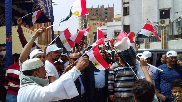 بالصور| مسيرة لحث الناخبين على الخروج للانتخابات في سوهاج