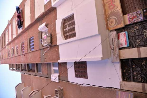بالصور| محافظ أسيوط: تشكيل لجنة هندسية لرصد ومعاينة العقار المائل بحي شرق