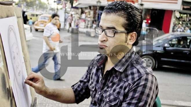 رسام شارع «شهاب»: وجه محمد مرسى لا يصلح للرسم