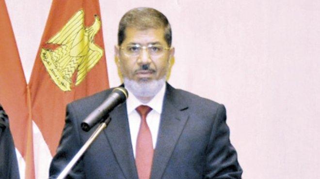 زوجة أحد الضباط المختطفين: مصدر أمنى رفيع أكد أن أزواجنا أحياء وإطلاق سراحهم يحتاج تدخل «مرسى»