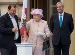 بالصور  الملكة إليزابيث الثانية تضيئ شعلة ألعاب الكومنولث