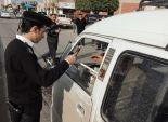 مرور بنى سويف يجبر سيارات الأجرة على وضع ملصقات بتعريفة الركوب