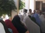 حملة مرسى توزع زيت وسكر على الناخبين بالأقصر